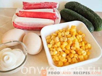 Crab stick salad with corn, eggs and cucumbers